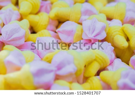 Background - assortment of delicious marmalade jelly candies looks like ice cream cones for sale on counter of shop, market, cafe. Dessert, copy space, sweet food, pattern, confectionery concept