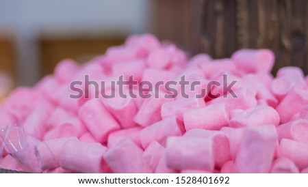 Background - assortment of delicious marshmallow candies for sale on counter of shop, grocery, market, cafe. Dessert, copy space, sweet food, pattern and confectionery concept