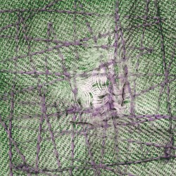 background based on a fragment of green jeans darned with zigzag seams