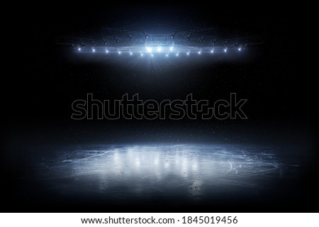 Background. Beautiful empty winter background and empty ice rink with lights. Spotlight shines on the rink. Bright lighting with spotlights. Isolated in black Stock fotó ©