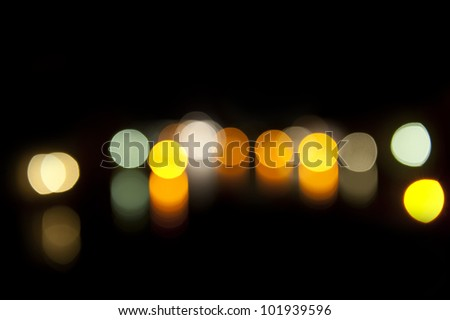 background bokeh lights on a black background creating an abstract effect