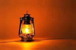 Background burning kerosene lamp, concept lighting