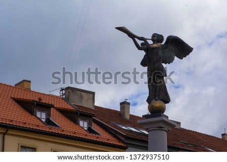 background cityscape view of the famous statue of a trumpeting angel, among the residential buildings of the district of Uzupis district, in Vilnius, Lithuania