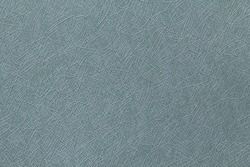 Background close up of seafoam green Japanese origami craft paper with crosshatched lines
