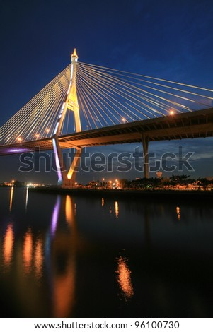 Background  closeup suspension bridge with reflection on the water
