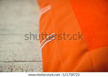 Background closeup textile of orange pet mattress