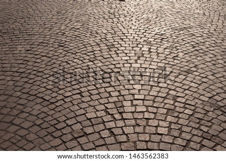 Background. Cobbles in the morning, evening light.