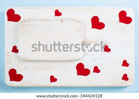 Background consisting of two wooden boards, painted with white paint and decorated with red hearts #344424128