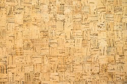 Background cork pin board made from small squares in low contrast