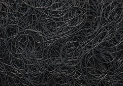 Background covered with a pile of electric cords filling the entire frame