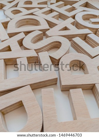 background decorated with typographies made in wood #1469446703