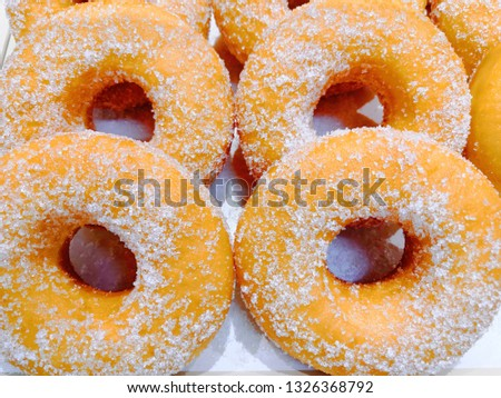 background Donuts sprinkled with sugar