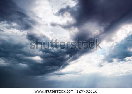 Background Dramatic dark sky with sun rays #129982616