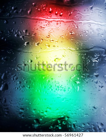 Background. Drops of a rain in the light of a traffic light.
