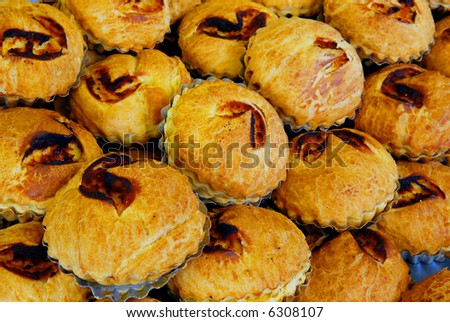 background filled with baked pastry pies