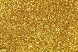 Background filled with shiny gold glitter.