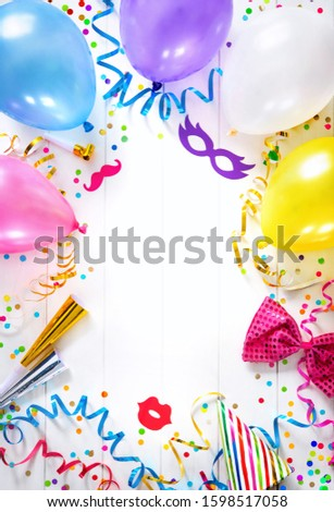 Background for carnival, birthday, New Year or other festivities with air balloons, streamers, confetti and party accessoires