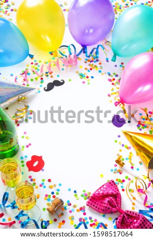 Background for carnival, birthday, New Year or other festivities with air balloons, streamers, confetti, party accessories and a pair of champagne glasses