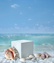 Background for cosmetic products on beach with sand. Geometrical concrete cube stone podium and seashells. Empty showcase for packaging product presentation. Mock up pedestal in sunlight sea view.