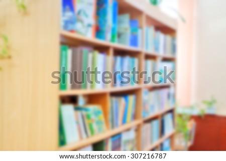 background for design : horizontal blurred library bookshelves
