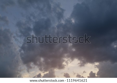 Background for design, sky texture with gray clouds at sunset or sunrise #1119641621