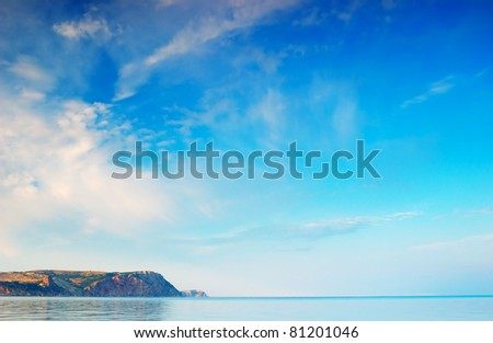 Background for design with the cloudy sky and the sea