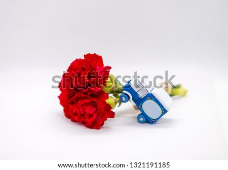 Background for postcards, greeting blue truck, red flower bouquet, red carnations, greetings birthday #1321191185