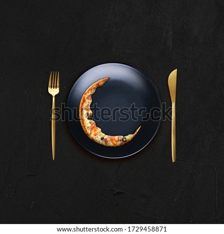 Background  for restaurants for  Ramadan & Eid celebration where pizza in half moon represents new moon for eid.