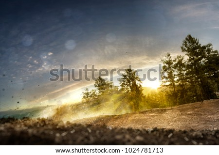 Background forest track dirt bike