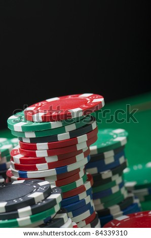 background formed for casino chips on a green felt - stock photo