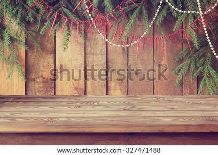 Background from boards with fir-tree branches from above, Empty wooden table, template, place for.