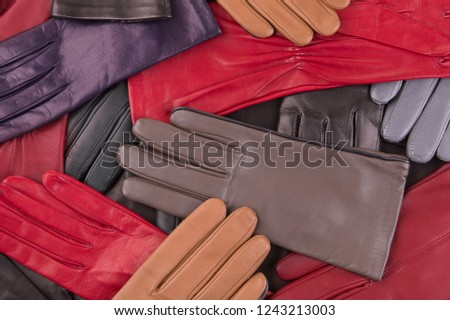 Background from colored leather gloves. Leather gloves close up.