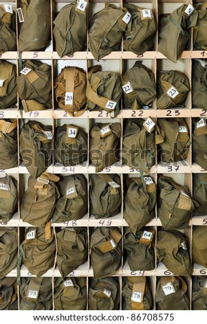 Background from folded gas masks in cells. Numbered and ready for use
