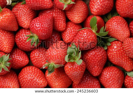 Shutterstock background from freshly harvested strawberries, directly above