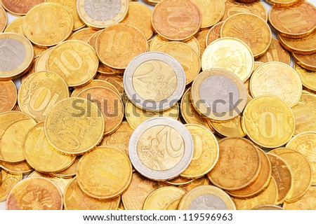 Background from gold coins. Many gold coins