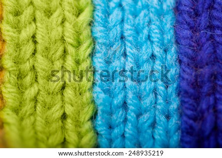 Background from knitted rainbow. texture of wool products. Comfortable home background.
