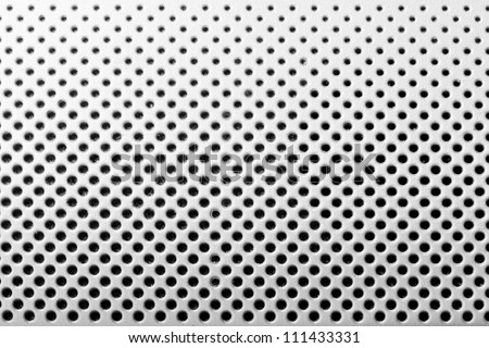 background from light metal plate with black holes