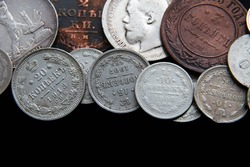 Background from old money of Imperial Russia. 19 - 20 century.Vintage multi-colored Russian coins (translation: Kopeck)