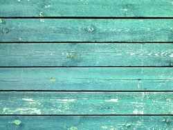 Background from old shabby wooden boards. Turquoise wood texture with peeling paint, grunge material