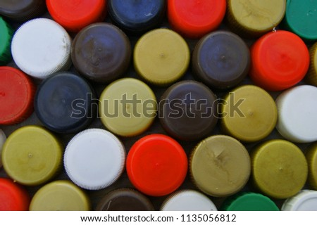 Background from plastic cap from bottles of the miscellaneous of the colour #1135056812