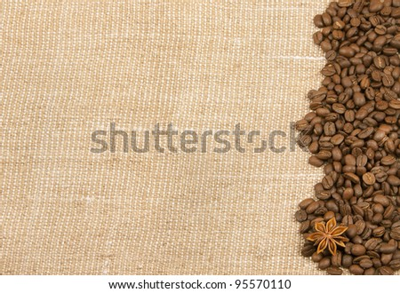 background from rough material with coffee is spilled on her bob and anise