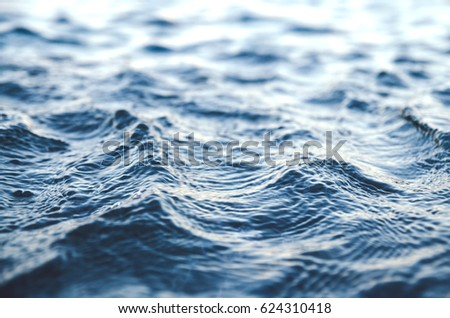 Background from sea waves. Small depth of selective focus  .  #624310418
