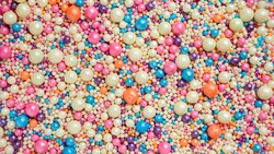 Background from small multi-colored balls. Abstract background for the holiday.