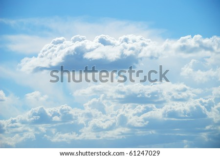 Background from soft white clouds against blue sky