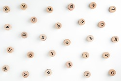 Background from the letters of the English alphabet on wooden cylinders. Stamps. Background for your text and design