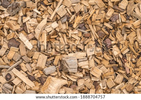 Background from timber sawdust chips - organic wooden surface on the ground ストックフォト ©
