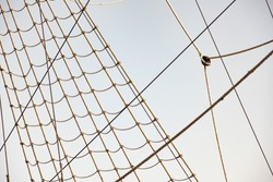 Background from vintage rigging rope system with pulley is close