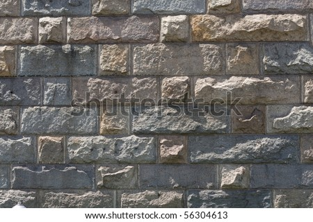 Background, granite block wall, old and weathered