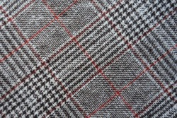 Background - gray and red Glen check fabric from above