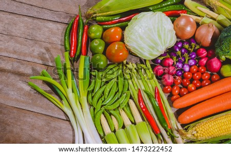 Background group of fresh food tasty and healthy varis vegetables are on the wooden table